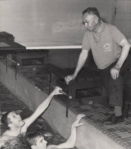 "Joseph C. ""Scrap"" Chandler with Men's Swimming Team, circa 1950-1959"